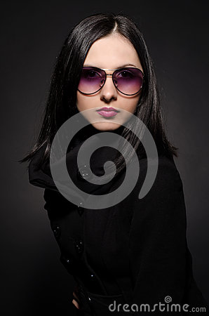 Portrait of a beautiful young woman in sunglasses