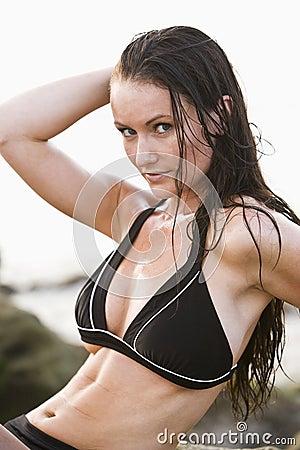Portrait of beautiful young woman wearing bikini