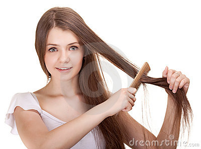 Portrait of a beautiful youth teen girl with comb