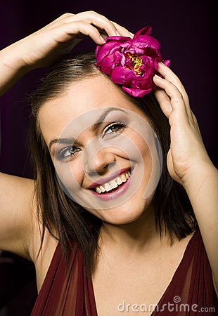 Portrait of beauty brunette woman with flower in her hair