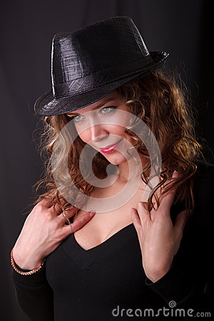 Portrait of beauty woman in dark hat