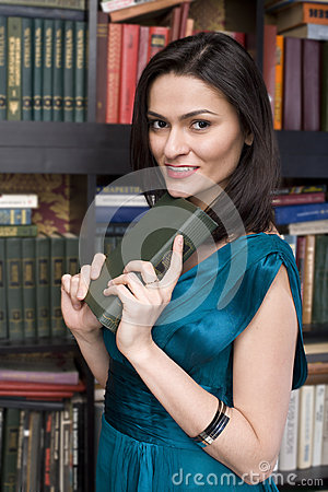 Portrait of beauty young woman reading book in library