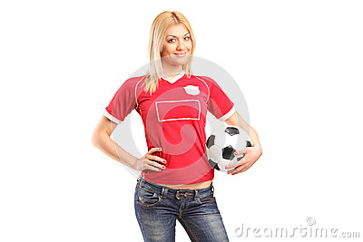 Portrait a blond female fan holding a football