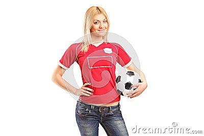 Portrait a blond female fan holding a football