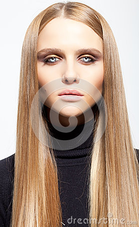 Portrait of blond girl with smoky eyes