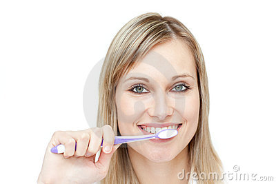 Portrait of a blond woman brushing her teeth