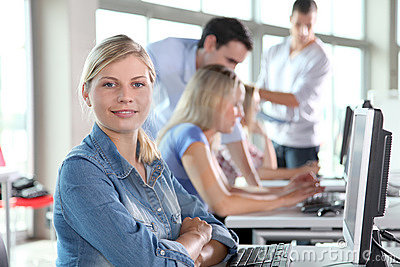 Portrait of blond woman in business training