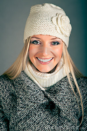 Portrait of blond woman in winter clothes