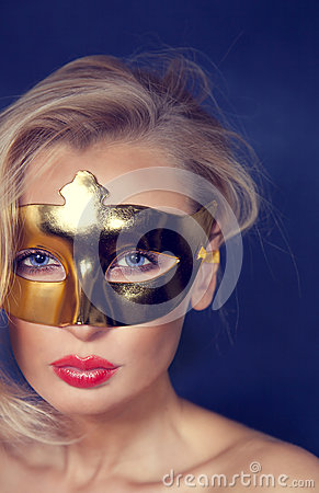 Portrait of blonde beauty in mask.