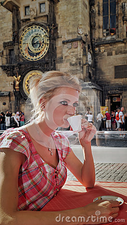 Portrait of blonde with cup of hot drink.