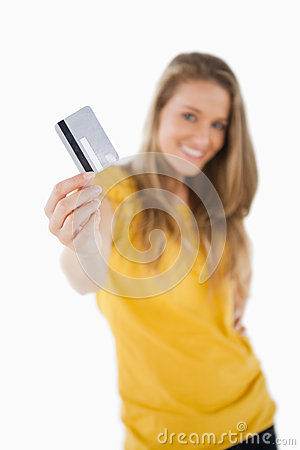 Portrait of a blonde student tending a credit card