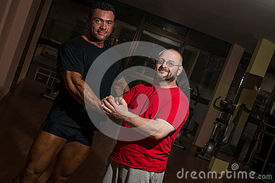 Portrait of bodybuilder and training partner
