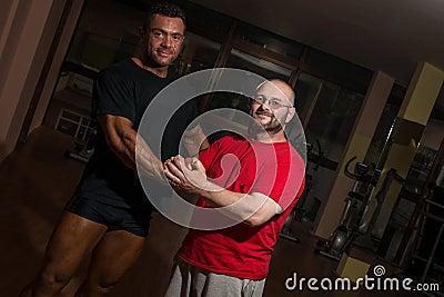 Portrait of bodybuilder and training partner
