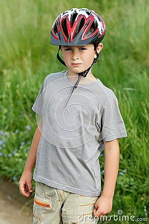 Portrait of boy bicyclist with helmet