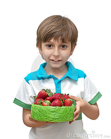 Portrait of a boy with a bowl of strawberries in t