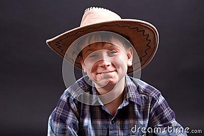 Portrait of a boy in a cowboy hat
