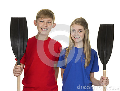 Portrait Of Boy And Girl Holding Canoe Paddle