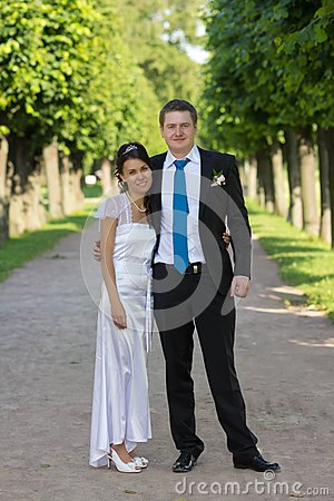 Portrait of bride and groom in the hands of the do