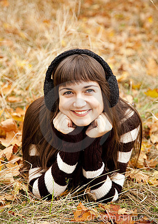 Portrait of brunette girl in the autumn park.