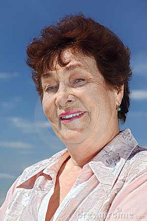 Portrait of brunette pensioner woman smiling Stock Photo