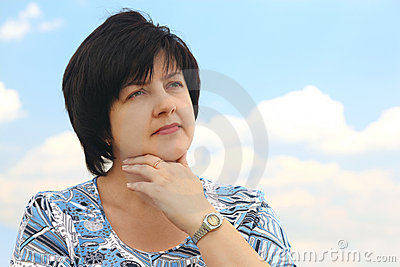 Portrait of brunette plumpy serious woman