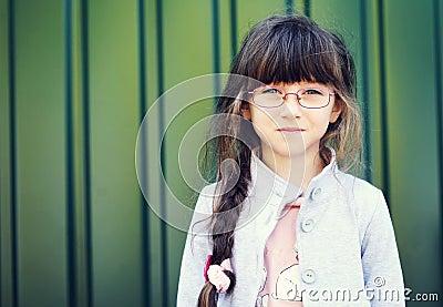 Portrait of brunette toddler girl in glasses