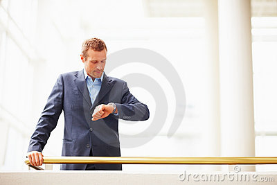 Portrait of a business man checking the time