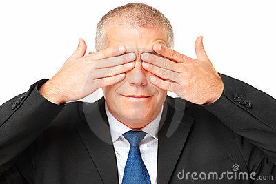 Portrait of business man covering eyes