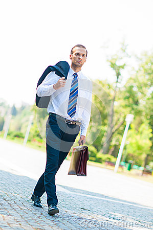 Portrait of business man walking