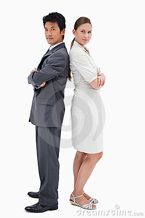 Portrait of business people standing back to back