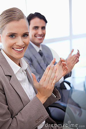 Portrait of a business team applauding