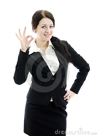 Portrait of business woman gesturing okay sign.