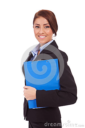 Portrait of a business woman holding a clipboard