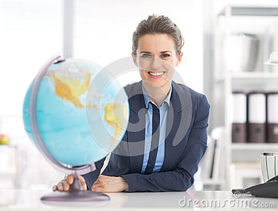Portrait of business woman holding earth globe
