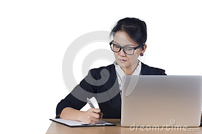 Portrait of business woman with laptop writes on a document at h