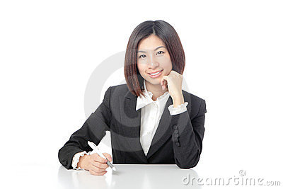 Portrait of Business woman sitting on desk