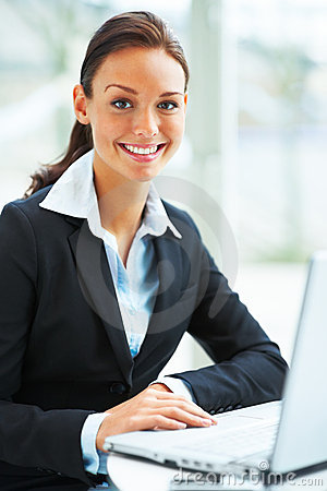 Portrait of Business woman smiling with laptop