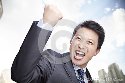 Portrait of Businessman Cheering with Fist raised, Outdoors, Beijing