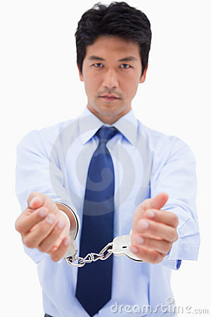 Portrait of a businessman with handcuffs