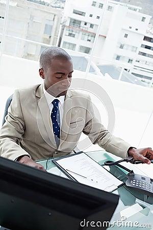 Portrait of a businessman hanging up