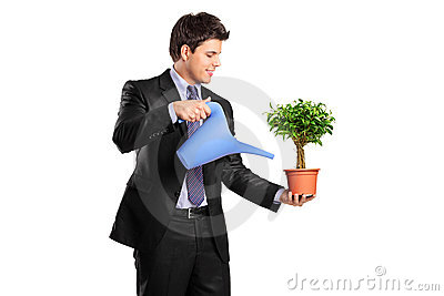 Portrait of a businessman holding a flower pot