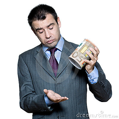 Portrait of businessman holding money box