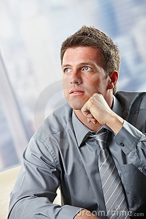 Portrait of businessman looking up thinking