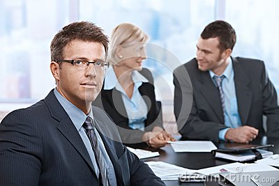 Portrait of businessman at meeting