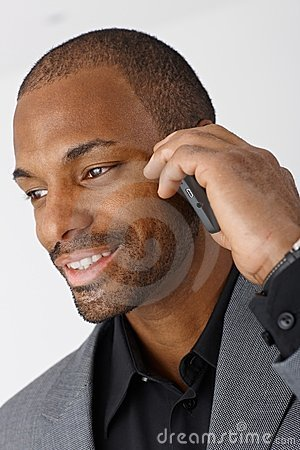 Portrait of businessman with mobile phone