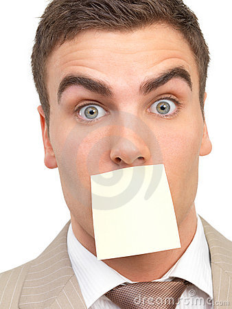 Portrait of a businessman, mouth shut by a note.