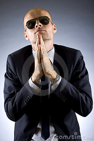 Portrait of businessman praying for success