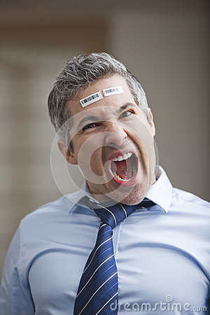 Portrait of a businessman shouting with barcode on forehead