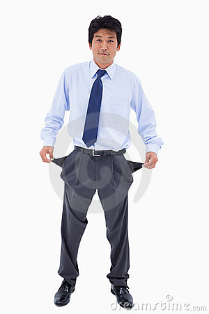 Portrait of a businessman showing his pockets