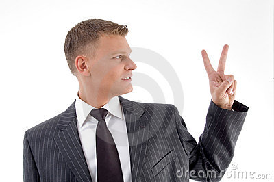 Portrait of businessman showing peace sign